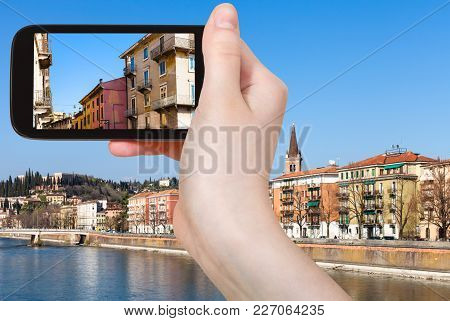 Travel Concept - Tourist Photographs Urban Houses In Verona City In Italy In Spring On Smartphone