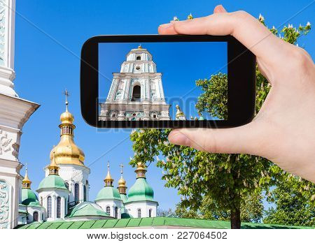 Travel Concept - Tourist Photographs Bell Tower Of Saint Sophia Cathedral In Kiev City In Ukraine On