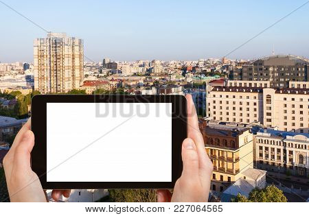 Travel Concept - Tourist Photographs Kiev City In Ukraine In Spring Sunrise On Tablet With Cut Out S