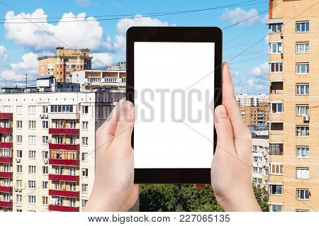 Travel Concept - Tourist Photographs Residential Quarter In Moscow City In Russia In Summer On Table