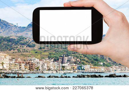Travel Concept - Tourist Photographs Giardini-naxos Town In Sicily Italy In Summer Season On Smartph