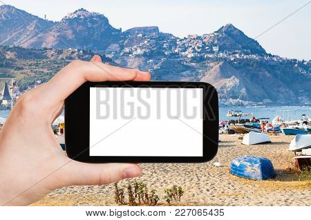 Travel Concept - Tourist Photographs Urban Sand Beach And Old Port In Giardini-naxos Town In Sicily