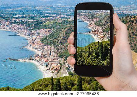 Travel Concept - Tourist Photographs Giardini Naxos Town Of Shore Of Ionian Sea From Taormina City I