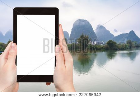 Travel Concept - Tourist Photograps Water Of Yulong And Jinbao Rivers And Karst Peaks In Yangshuo Co