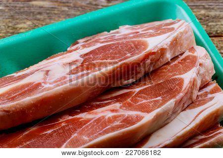 Organic Red Raw Steak Sirloin Against A Background