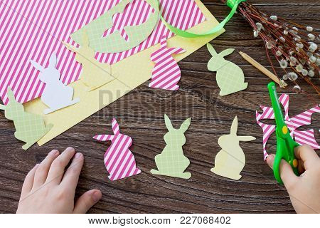 The Child Draws Details Festive Easter Decor With Handmade Decoration Of Colorful Rabbits On A Woode