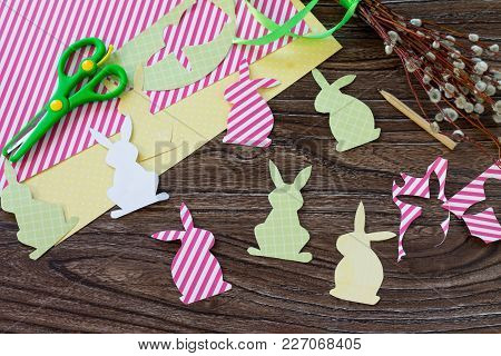 Festive Easter Decor With Handmade Decoration Of Colorful Rabbits On A Wooden Background. Project Of