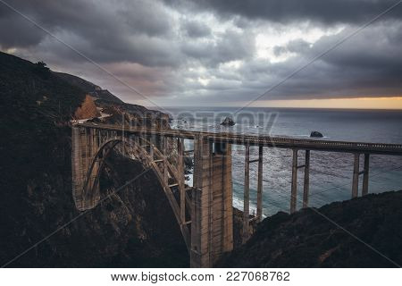 Scenic Panoramic View Of Historic Bixby Creek Bridge Along World Famous Highway 1 In Beautiful Eveni