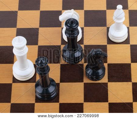 Image Of Wooden Checkerboard With Figures At Day
