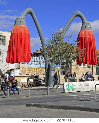 Jerusalem, Israel - December 1, 2017: Red Flowers Tourist Attraction On The Mahane Yehuda Square In