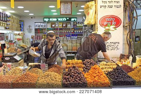 Jerusalem, Israel - December 1, 2017: Men Are Selling Dried Fruits And Nuts At Machane Yehuda Market