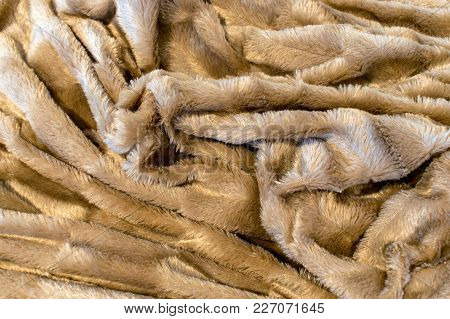 A Beige F Aux Fur Blanket Folded In A Way To Create Many Random Folds And Textures