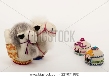 Oriental Toy Made By Own Hands Two Camels On A White Background