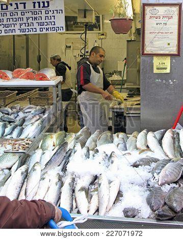 Jerusalem, Israel - December 1, 2017: Man Is Fish At Machane Yehuda Market In Jerusalem, Israel