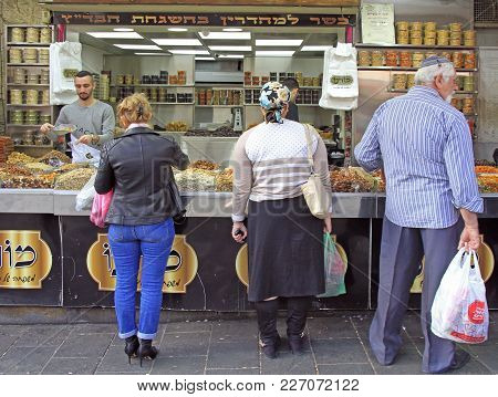 Jerusalem, Israel - December 1, 2017: Man Is Selling Dried Fruits And Nuts At Machane Yehuda Market