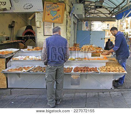 Jerusalem, Israel - December 1, 2017: Man Is Selling Pastries At Machane Yehuda Market In Jerusalem,