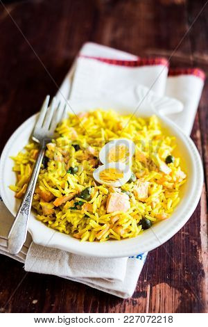 National Scottish Dish Kedgeree With Roasted Basmati Rice, Curry Powder And Fish In A Plate, Selecti