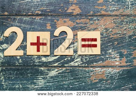 Simple Mathematical Equation, 2 Plus 2, On Rustic Wooden Surface