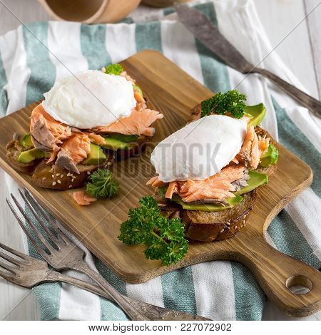 Eggs Benedict, Scandinavian Style - With Avocado And Poached Salmon. Top View.