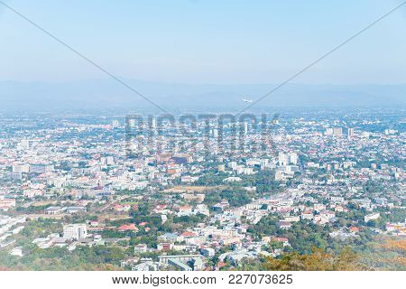 Distant View Chiang Mai City From Doi Suthep Mountain From Green Bush Clad  Mountain Slope Over Urba