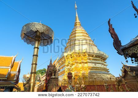 Large Golden Chedi Surrounded By Buddhist Architectural Structures  On Doi Suthep Mountain Wat Phrat