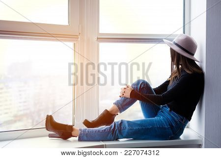 Beautiful Boho Woman In Wool Hat Sitting By The Window