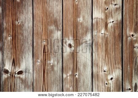 Fragment Of Fence Built Of Weathered Unfinished Wooden Boards
