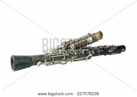 Used Vintage Broken Clarinet On White Background