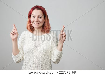 Positive And Charming Redhead Girl Wearing White Sweater, Expressing Excitement While Making With Or