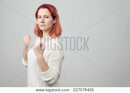 Attack Position Of Confident Woman Being Ready To Fight Looking On Her Offender. Boxer Girl Going To