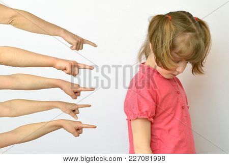 many hands are pointing fingers at the child ,kid of the outcast conceptual photography
