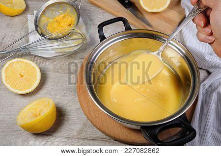 Freshly Prepared Lemon Kurd - Custard On Fruit Juice, In A Saucepan Stir With A Spoon