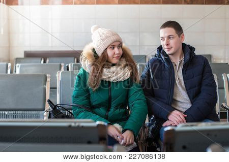 Couple In Warm Clothes In The Waiting Hall At The Station