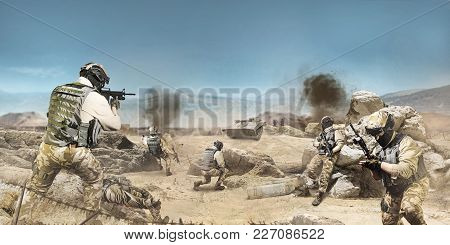 Photo Of A Soldiers Fighting And Atacking On A Desert Battlefied Background.