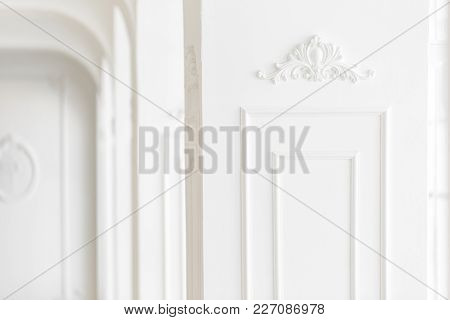 Expensive Luxury Interior. Stucco Elements On Light Column. White Patterned. Mouldings Element From