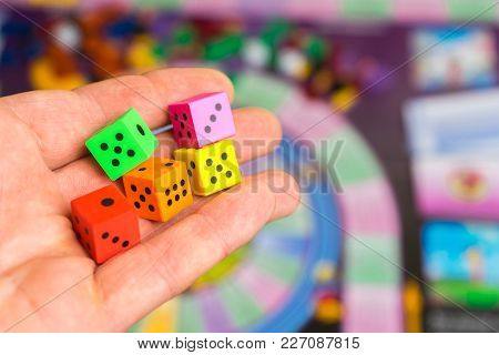 Man Throws The Dice On The Playing Field. People Play Board Games. Copy Space