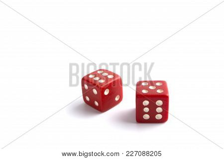 Red Dice In Air Rolling With Shadows Isolated On White Background