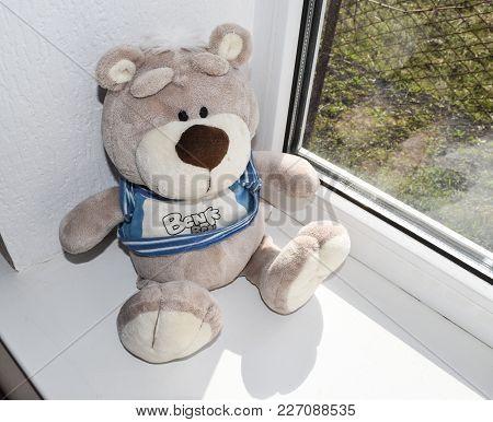 Krasnodar, Russia - February 14, 2015: Toy Is A Teddy Bear On The Windowsill.
