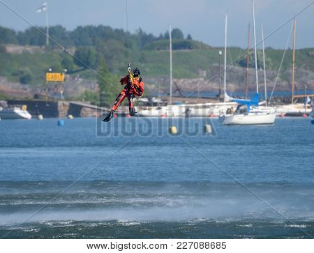 Helsinki, Finland - June 9: Unidentified Finnish Coast Guard Rescue Swimmer Drops Down To The Baltic