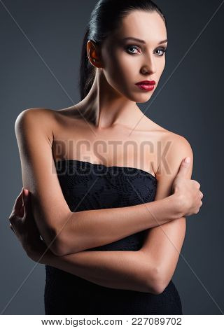 Studio Fashion Shot: An Attractive Young Woman Dressed In Black