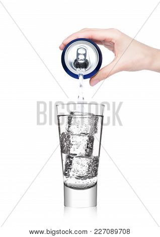 Female Hand Pouring Sparkling Mineral Water From Aluminium Can To Glass On White Background