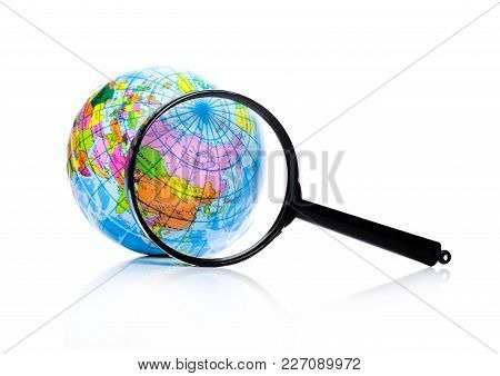 Globe Under Magnifying Glass Zooming Russia And China On White Background
