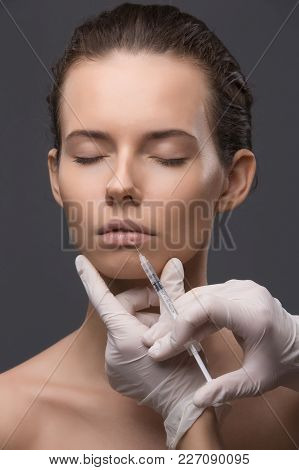 Portrait Of Young Woman Getting Cosmetic Injection. Clean Beauty.