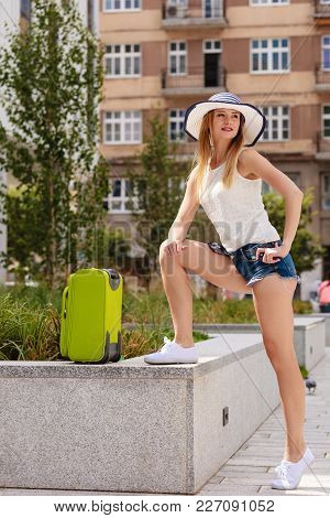 Adventure, Teenage Journey Concept. Attracitve Woman Ready To Travel Wearing Denim Shorts, White Top
