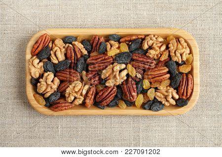 Mix Of Big Peeled Walnuts, Big Peeled Pecan Nuts, Big Dark Blue Raisins And Yellow Raisins In Bamboo
