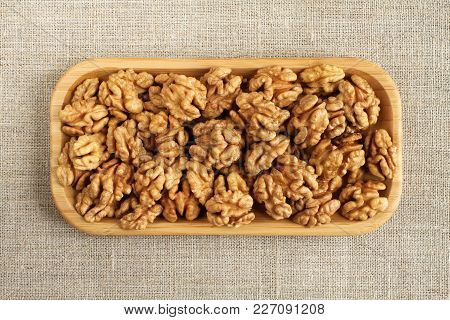 Big Peeled Walnuts In Bamboo Plate On Rough Linen Cloth