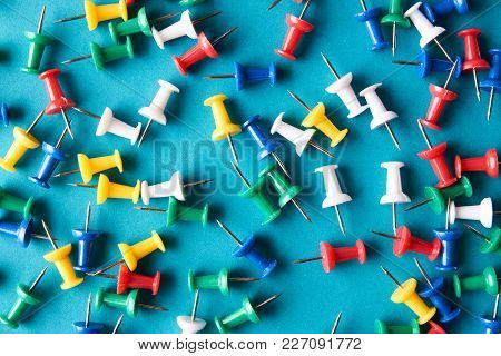 Push Pins On Blue Background, Close-up. Colorful Pushpins Or Colored Thumbtacks To Remember Things T