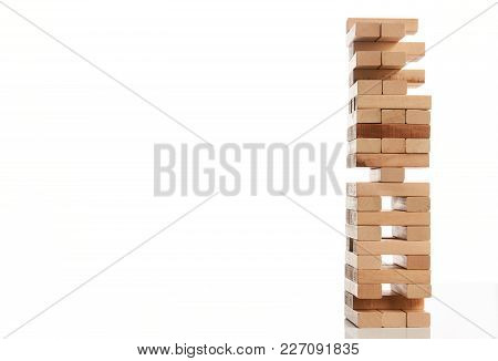 Wooden Blocks Tower Isolated On White Background With Copy Space, Close-up. Strategy Game As A Busin