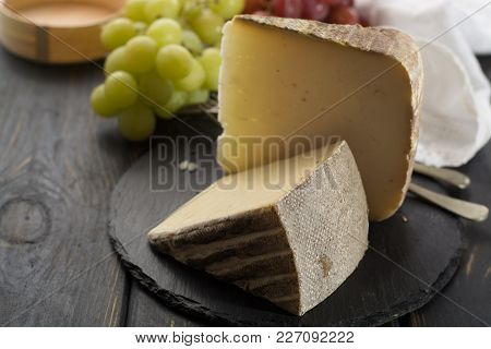 Tasting Of Ancient French Demi Soft Cheese Tomme From French Alps, Made From Cow, Goat Or Sheep Skim