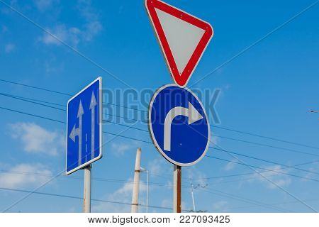 A Sign That Shows The Road And Turn Only Right To The Background Of A Brilliant Blue Sky.
